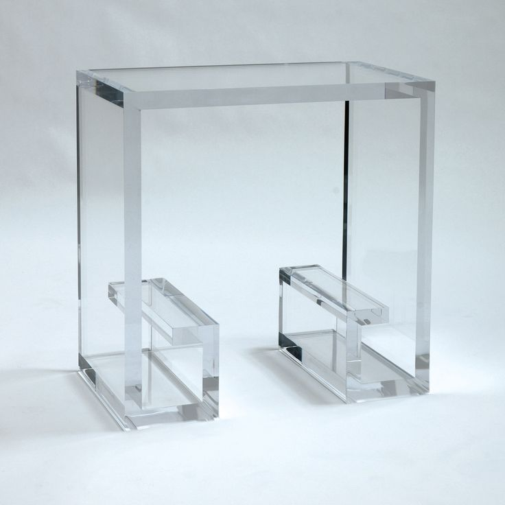 very tiny glass table with square grid architecture and thick glass materials and there storage space newspapers in sturdy legs
