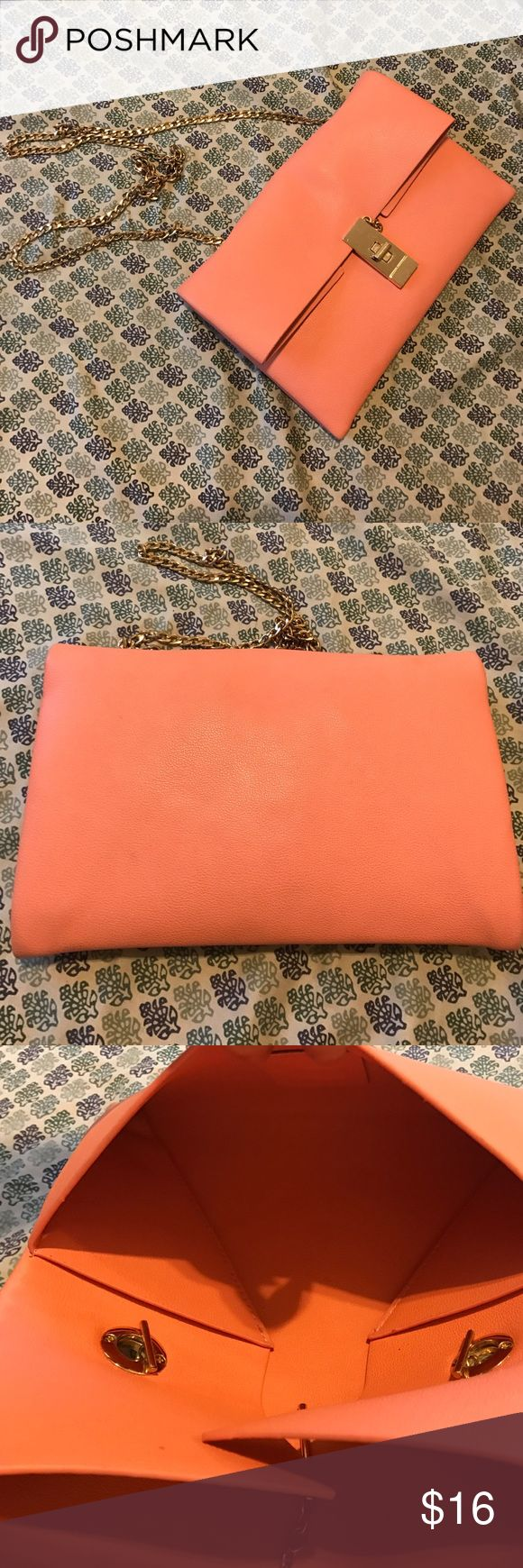 Peach clutch with gold chain Purchased at local boutique. No brand on item. Man made materials. Almost perfect condition. Inside flawless. Tiny bit of wear on the back, smaller than a dime. Bags Clutches & Wristlets
