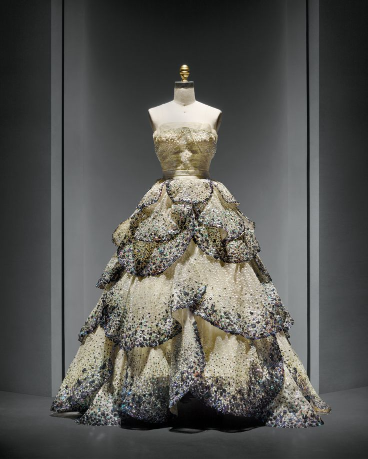 """House of Dior (French, founded 1947), Christian Dior (French, 1905–1957). """"Junon"""" Dress, autumn/winter 1949–50, Haute Couture. Machine–sewn, hand–finished pale green silk faille and taffeta foundation, hand–sewn pale blue silk tulle embroidered with opalescent sequins, hand–applique of forty–five hand–cut pale blue silk tulle and horsehair petals, hand–embroidered with opalescent, blue, green, and orange gelatin sequins. Photo © Nicholas Alan Cope."""