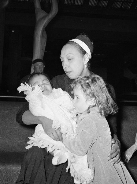 Josephine Baker tried to combat racism by adopting 12 children of different ethnicities from around the world.   holds in her arms her 10th adopted child, a boy from Venezuela, as another of her adopted children looks on. 1959. age 53 #actor