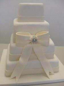 Four tier ivory square wedding cake 225x300 Square Wedding Cakes with Bows