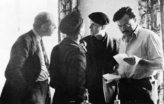 Lost Generation:  Ernest Hemingway (far right) with John Dos Passos (far left), Joris Ivens (back to camera), and Sidney Franklin in Madrid during Spanish Civil War.  (c) Bettmann/Corbis