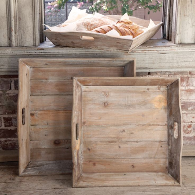 Whether used to serve snacks or as a display for books, frames, or plants, these reclaimed wood trays, featuring cut out handles, are sure to add rustic vintage charm to any space.
