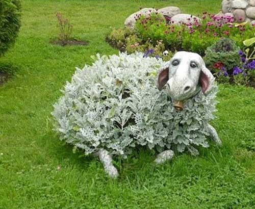 Love this! A natural bush (looks like dusty miller) and add a ceramic sheep head? and feet to look like a critter in the yard. too cool!
