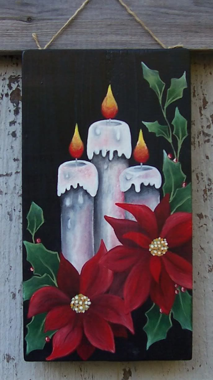 Christmas candles/poinsettias painted on plywood with acrylic paint.