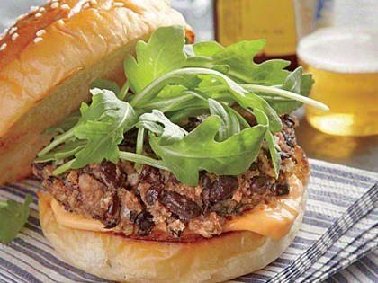 Black Bean Burgers with Sriracha Aioli | Add zesty Black Bean Burgers with Sriracha Aioli to your mealtess dinner options. They're superfast to make and will become a fast favorite as well.
