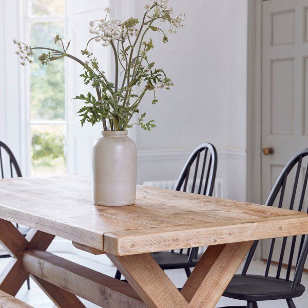 Reclaimed Wood Plank Trestle Dining Table. Solid salvaged timber refectory farmhouse kitchen table. Made from vintage planks and beams resembling a door.