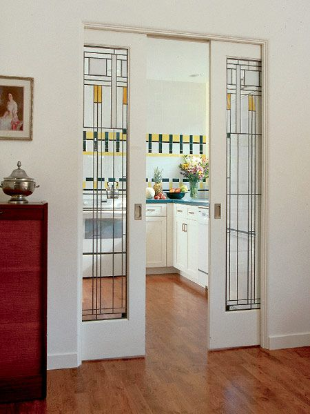 Craftsman style - pocket doors with Lloyd Wright-esque stained glass. Oh my. I will not covet!