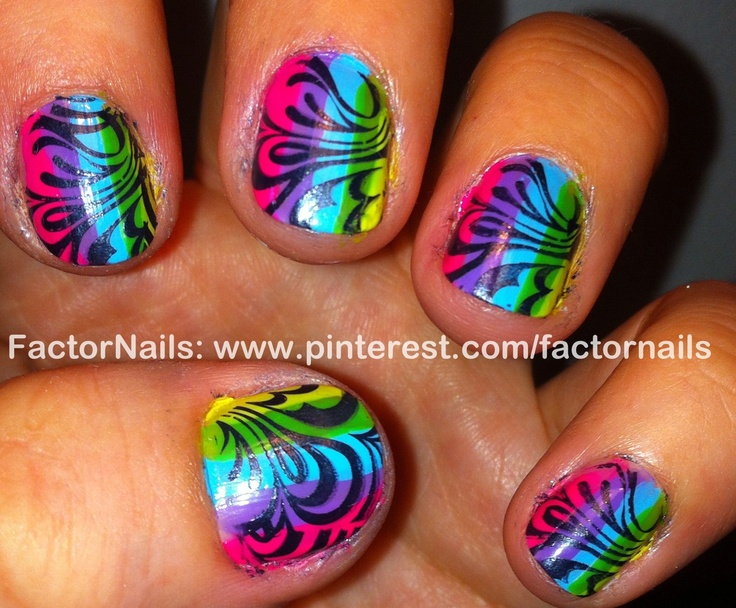 Fun with neon 2 -- I like the design over the colors, but I think I'd like the overall mani better if they had a little side to side rainbow gradient going on.