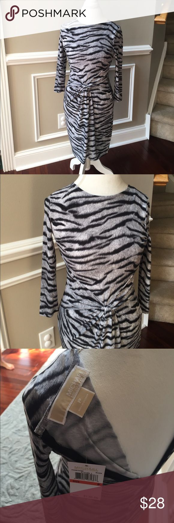 NWT Michael Kors Tiger Print Dress! NWT Michael Kors Tiger Print Dress! Zipper closure on the back. Gathered design on the front. Black, white and grey deign. Soft poly/spandex blend. Size petite, fits a small, has some stretch. Michael Kors Dresses Midi