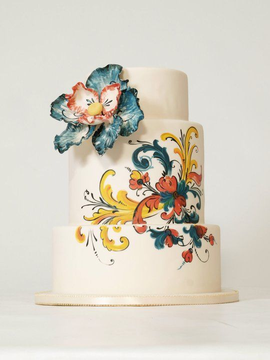 wedding cake. Covered in fondant and painted on with food color, or petal dust mixed with vodka. Actually pretty easy to do as long as your decorator has any artistic ability.