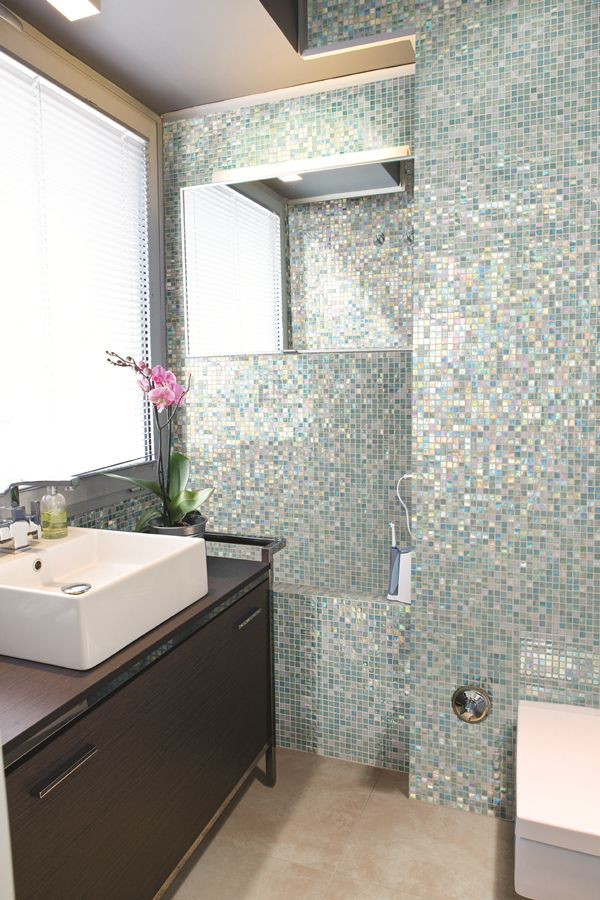 Love a shimmery mosaic tile floor to ceiling in a bathroom! <3 http://www.carpetone.com/tile-category