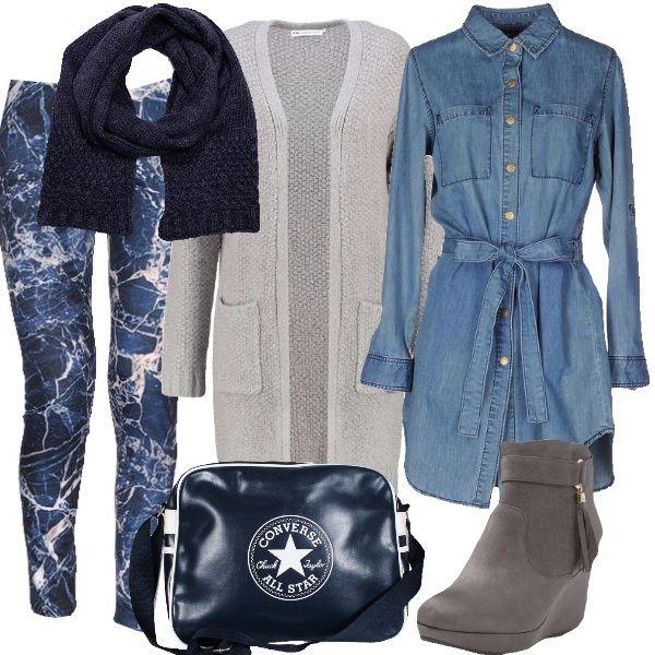 I leggings blu stampati con getti di colore come un quadro si abbinano alla camicia lunga in jeans lavaggio chiaro abbottonata fino al collo e con fusciacca in vita nello stesso tessuto. Completiamo con un cardigan lungo grigio chiaro con tasche in lana calda. Ai piedi stivaletti con zeppa e nappine laterali in suede grigio chiaro e come borsa tracolla sportiva blu con logo del marchio a vista. Per finire sciarpa blu in lana per proteggere il collo.