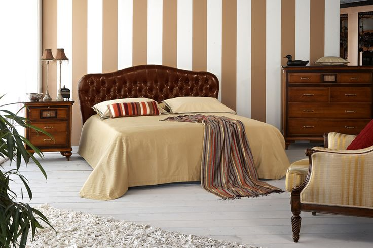 Estasi bed in brown leather and capitone
