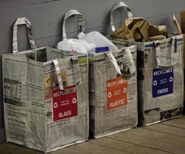 The Newspaper Recycling Bag is crafted entirely of recycled newspaper and magazines sealed in recycled plastic. It's easy to clean and a great way to keep your recyclables organized. Place them in your kitchen or mudroom for a quick and easy way to be environmentally responsible. Order yours today!  Made entirely of recycled materials.  Available in three varieties: paper, plastic and glass.