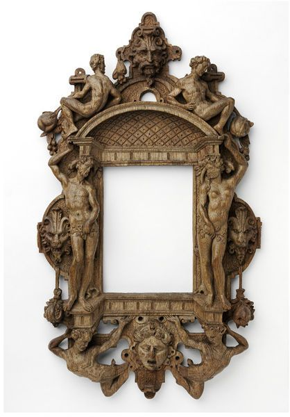 Carved oak strapwork frame with figures of Adam and Eve, originally painted and gilded.