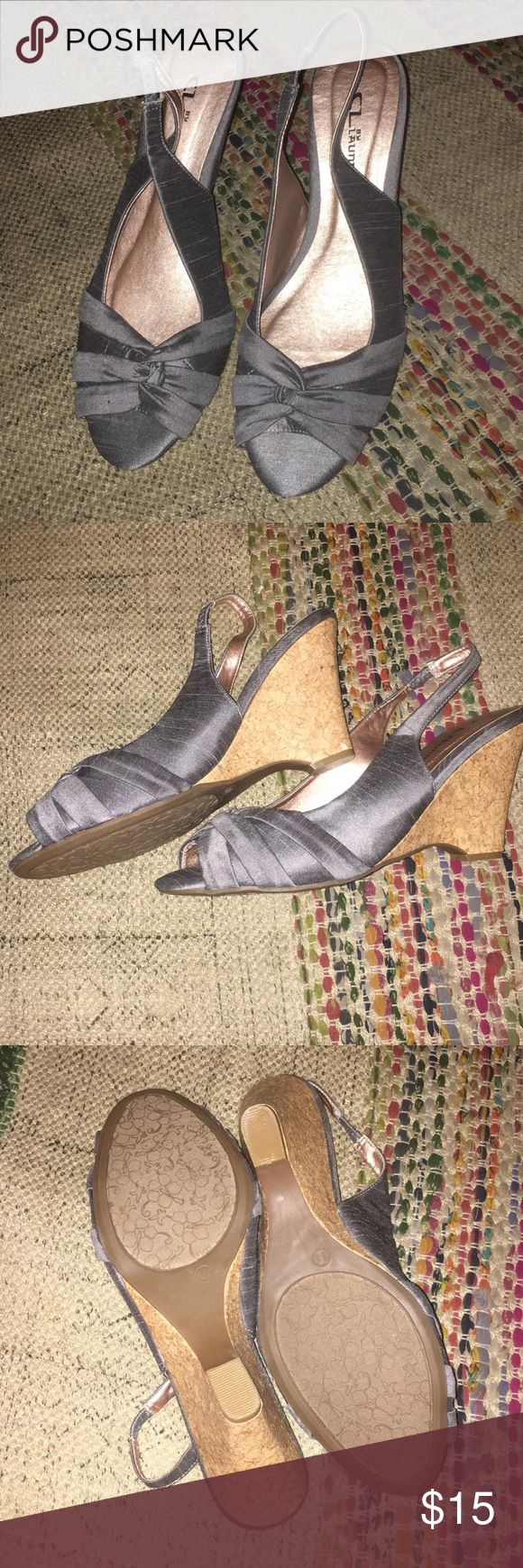 Silver/gray satiny wedge heels. Never worn Never worn beautiful gray/silver wedge heels 4 inch wedge, incredibly comfortable, great for holiday parties and weddings Chinese Laundry Shoes Wedges