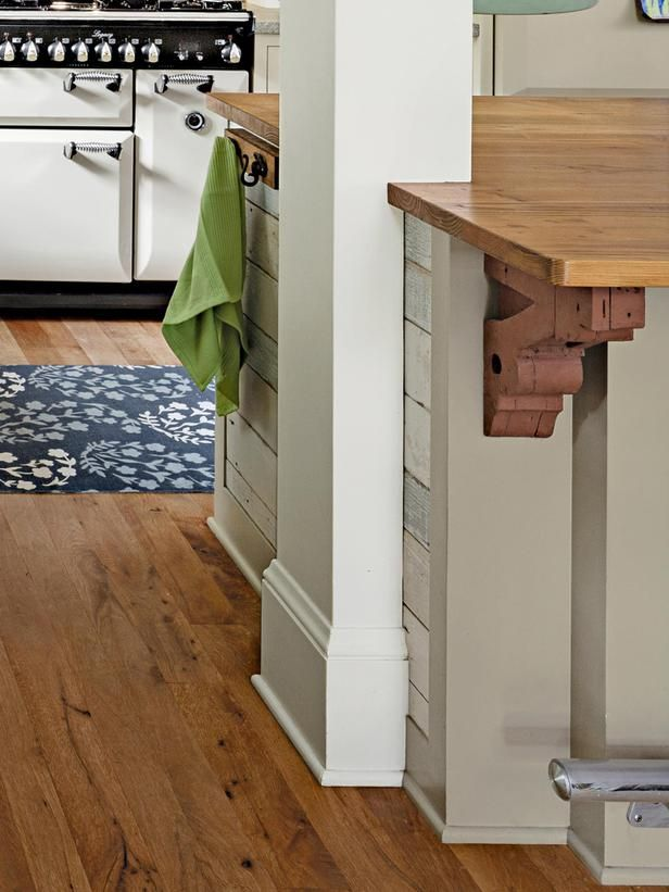make other load bearing wall to incorporate island. May minimize kitchen space.