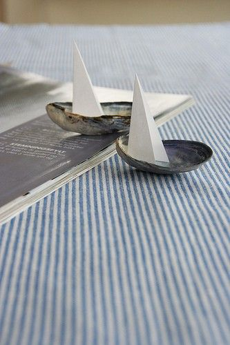 Simple, adorable: sailboats made from shells & paper... This will look great with our new nautical themed bedroom :)