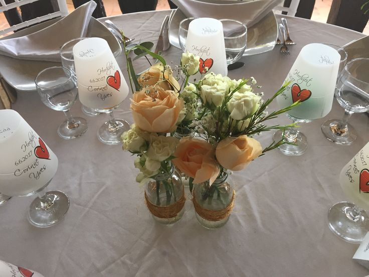 CBV261 weddings riviera maya peach and white flowers bottle centerpiece / centro de mesa de botellas con flores durazno y blancas
