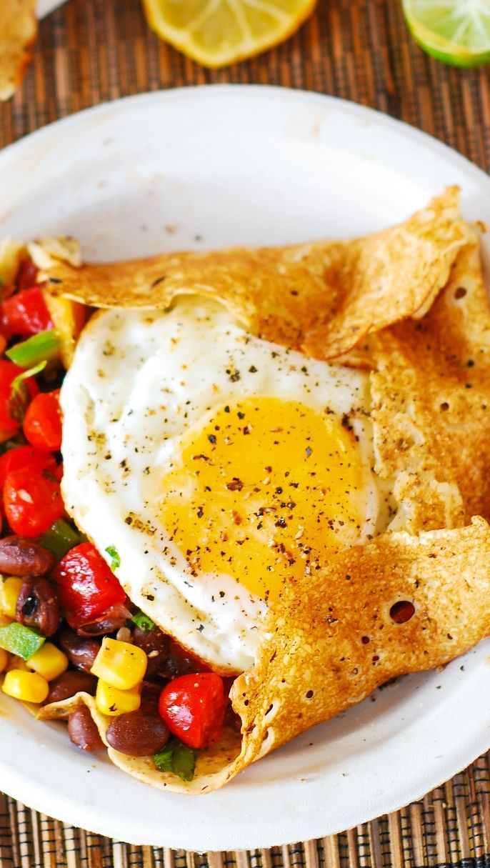Light and skinny Southwestern breakfast crepes: eggs, black beans, tomatoes, corn, bell peppers