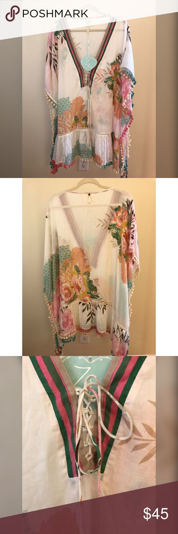 NEW Z&L Caftan, Beach Cover-up, or Dress Can be worn as a caftan/beach cover-up or dress. Colorful tropical floral print. Lace-up v-neck with colorful stripe trim detail. Flirty ruffle hem with colorful Pom trim. About Z&L: The brand is designed for the free spirit, bohemian and romantic woman who wants her wardrobe to reflect her unique eclectic style. Sold at Revolve, Everything But Water, Forever 21 Brands Store. Z&L Swim Coverups