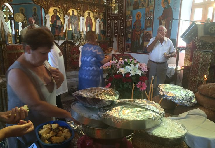 Cakes and Artos laid out at the altar on St. Fanourios Day, Aug. 27th, Ikaria Island, Greece