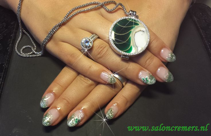 green glittery almond nail oblique French manicure with a flower nail art and strass bling bling