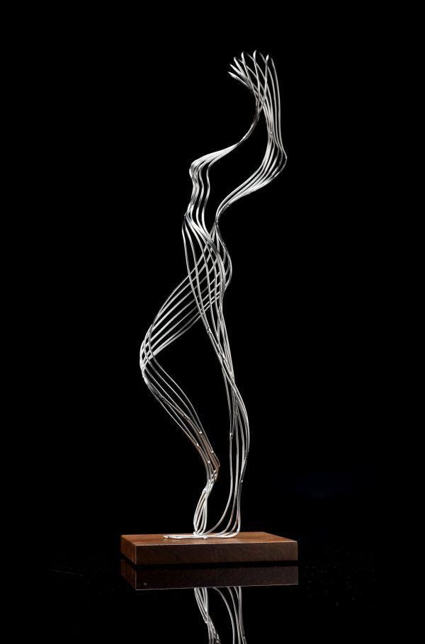 Improvised figure by Martin Debenham, sculpture in stainless steel with wood base, 2011