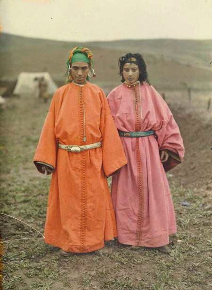 The robed women are from a village, or douar, outside of Sidi Kacem.Morocco.