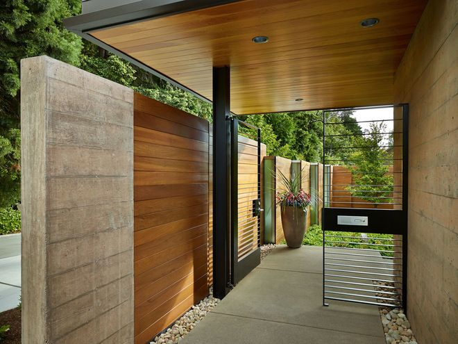 """""""The progression through the space starts at this courtyard entry gate. Board-formed concrete gives way to ipe wood as you move into the courtyard; a steel gate allows views through to the channel glass.""""  #Seattle #WA #Architecture   Via Houzz.com article:  http://www.houzz.com/ideabooks/15755174/list?utm_source=Houzz&utm_campaign=u336&utm_medium=email&utm_content=gallery0"""