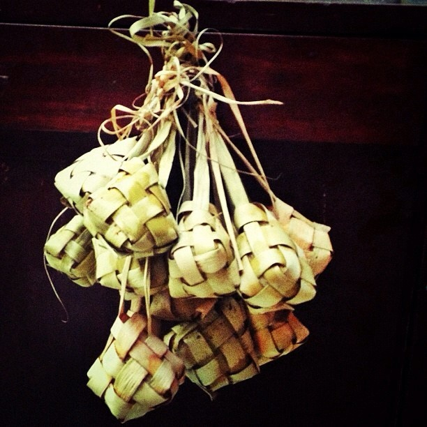 Ketupat - the most famous food served on Ied mubarak celebration in Indonesia usually companied with opor ayam (chicken curry) or rendang. Made from rice coated on cubical strings of coconut leaves.