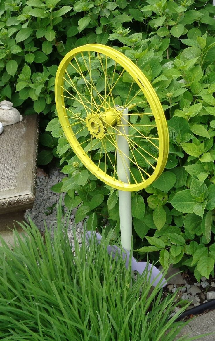 Bicycle Wheel Garden Art. bicycle wheel decoration for yards and gardens, wheel diameter varies 20-24 inch diameter. stenciled welcome.