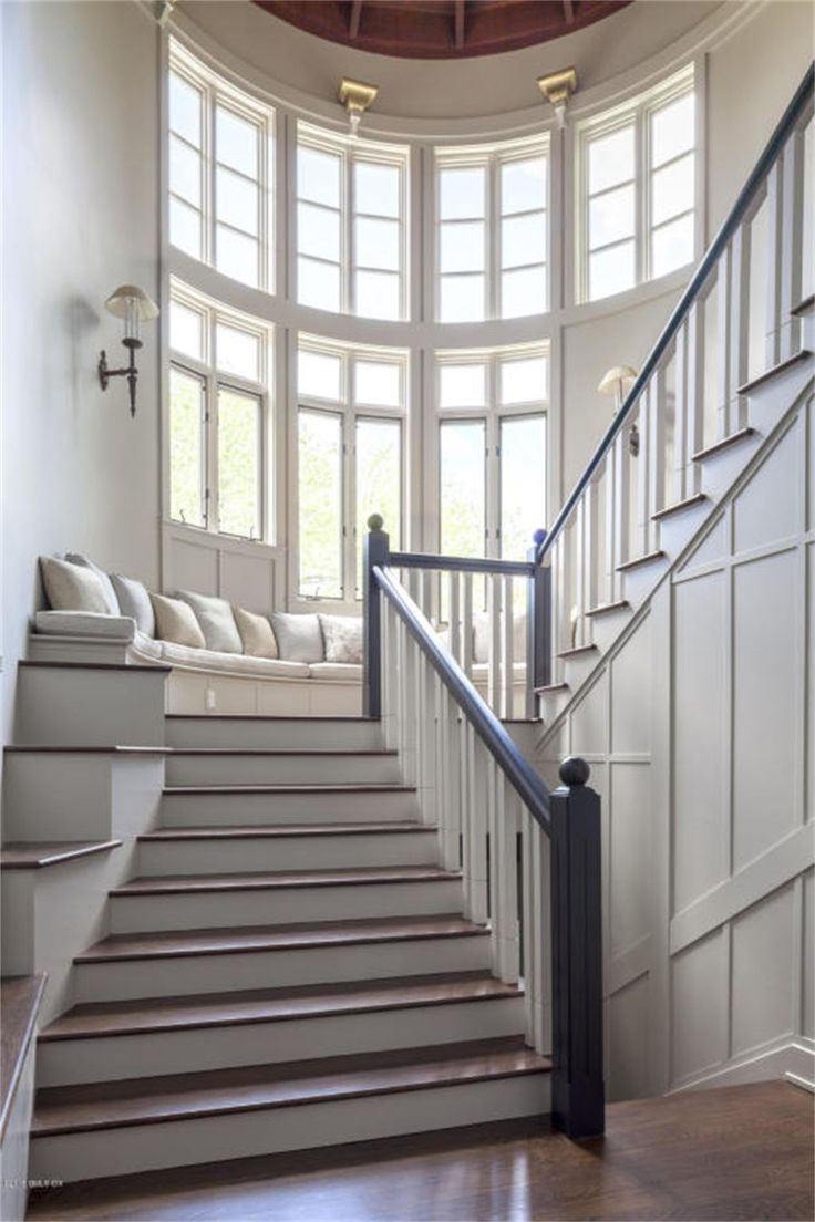 Staircase with window seat of luxury home in Redding, Connecticut