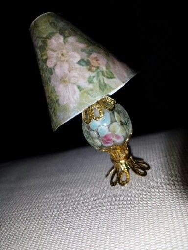 Victorian lamp with flower glass bodice and a floral lamp shade and gold accents
