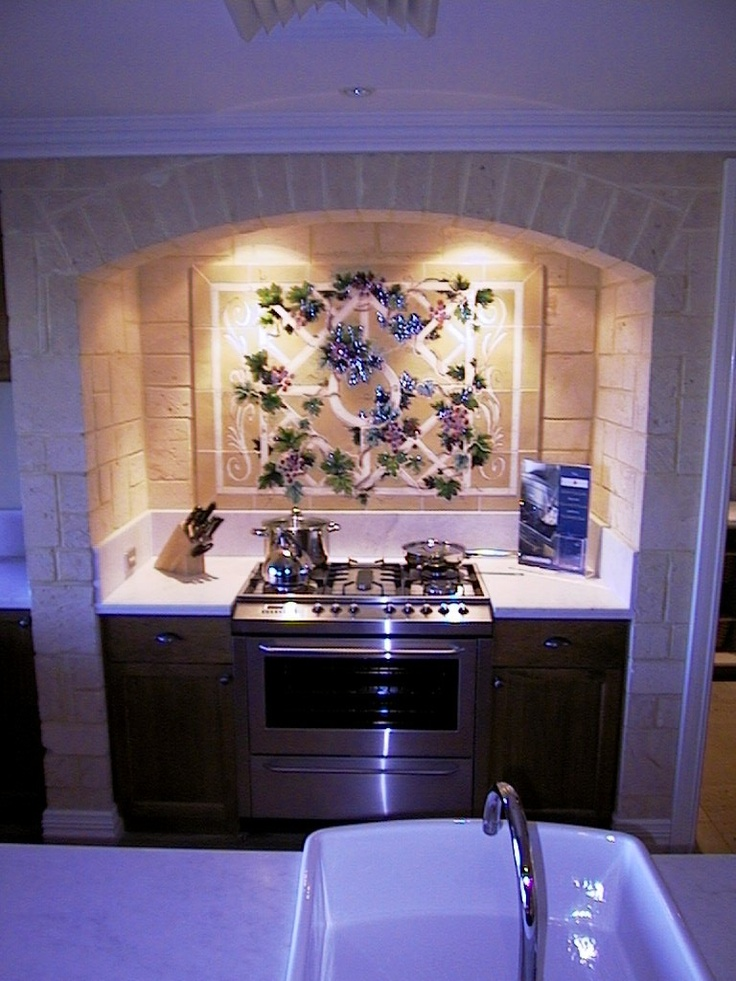 Pretty feature tiles in this country style kitchen
