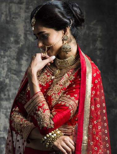 Sasya Weddig Bridal Lehenga - Bride in Gold and Red Saree Lehenga. Click for more information on WeddingNet #weddingnet #indianwedding #indianbride #indianwedding #bridallehenga #lehenga #pink #gold #beige #weddinglehenga #weddingsaree #bride #gown