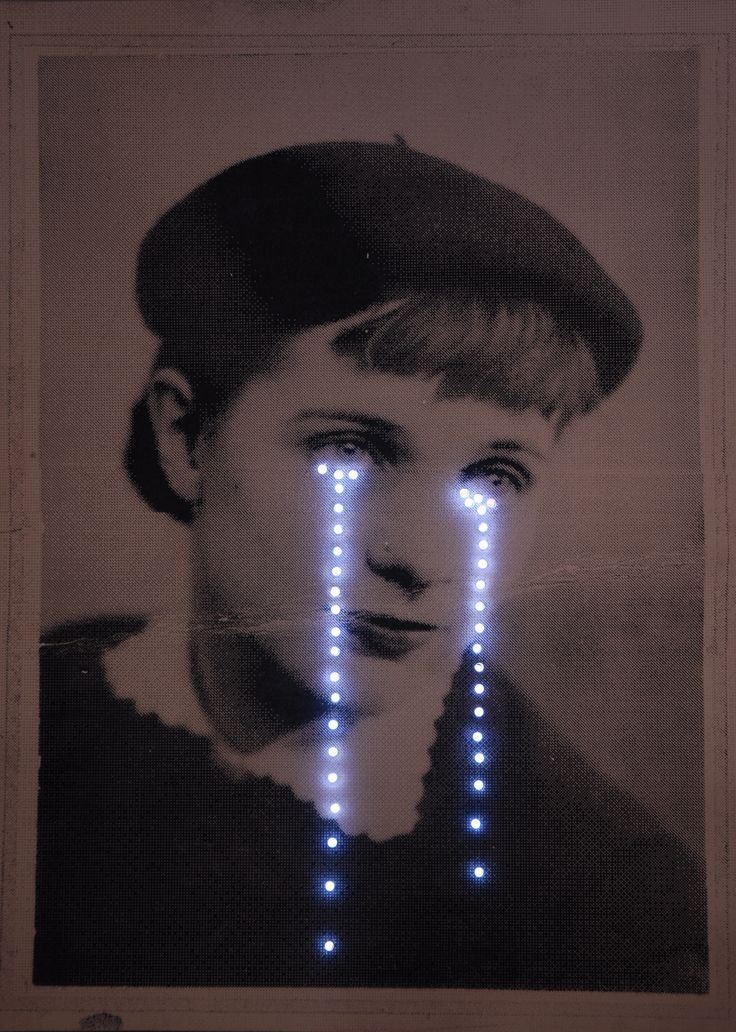 Her Glittering Tears - Daisy Hatton - silkscreen on wood with lights.  Daisy's A2 coursework was based on a generation women who felt their role was to always be pretty - even their tears should glitter.  This piece is presently on display in Cafe.Uneeka.  The original image is from a photo of Daisy's grandmother.