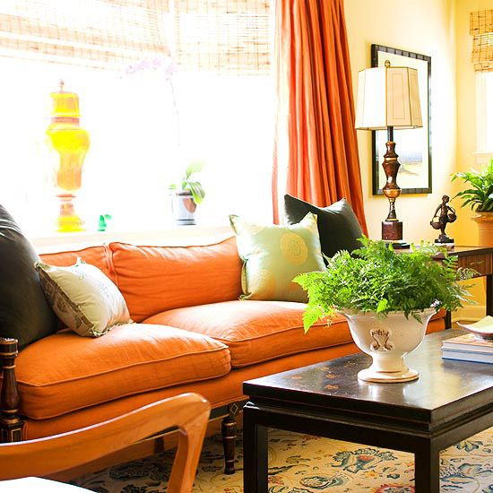 A sofa covered in orange linen!! In this case, orange acts as a neutral, inviting both cool and warm tones to be at home.