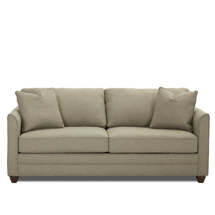 Feel happy and chic with this sleeper collection in your home. Fit for a sunroom or a guest room, this sleeper is a perfect companion. Two over two cushion design, accent arm pillows and thin, tapered arms make this sofa a keeper!