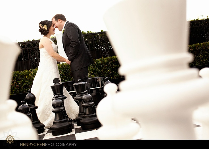 Awesome wedding, The London West Hollywood Hotel, giant chess board, cute groom and bride pose, strapless dress, wedding day hair and makeup, hair up, wedding location