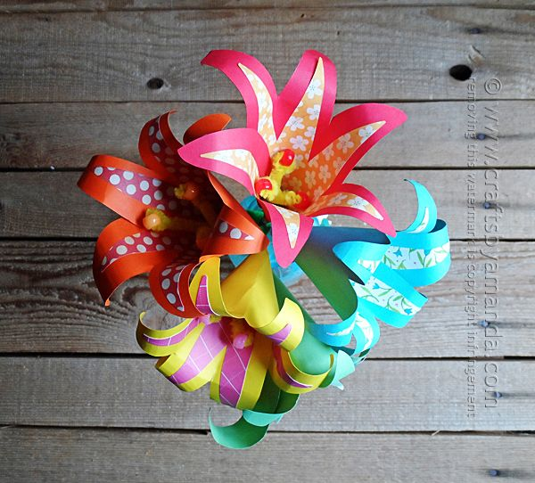 Make a bouquet of tropical paper flowers from cardstock and scrapbook paper! Instructions  from Amanda Formaro of Crafts by Amanda