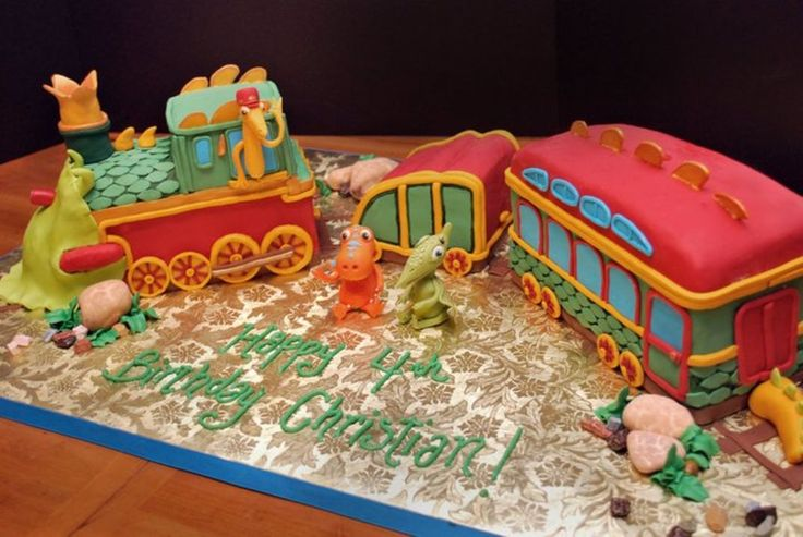 Dinosaur Train Cake Son LOVED these little guys! Buddy and Tiny from Dinosaur Train for Bday Cake. Sculpted Train, chocolate rocks,...