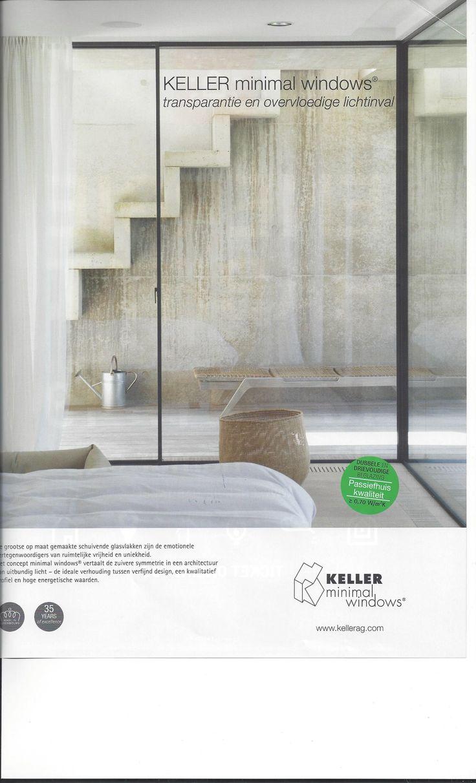 Super Fenster sehr dünne Rahmen auch Hersteller schöne verwitterte Betonwand aussen