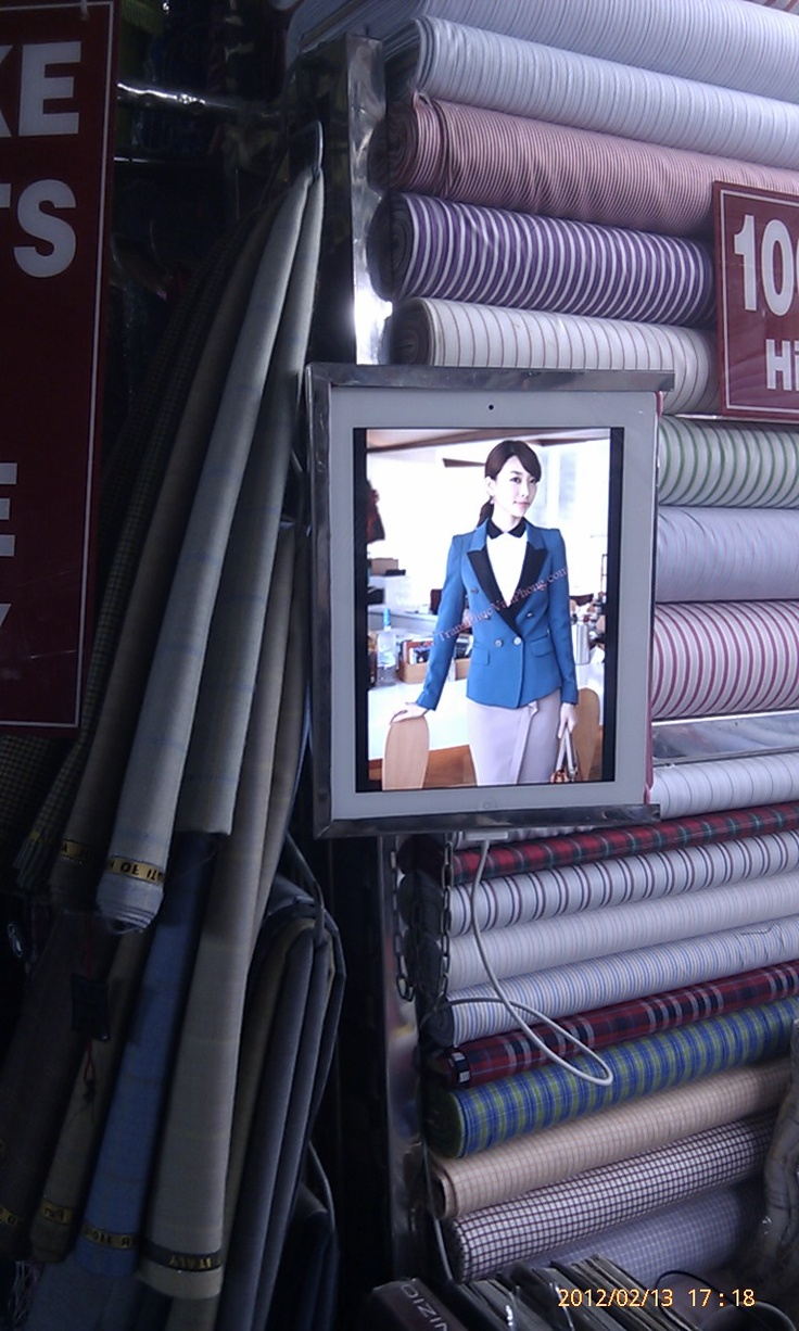 ipad is a convenient and portable display device for tailors in Banh Tanh Market.