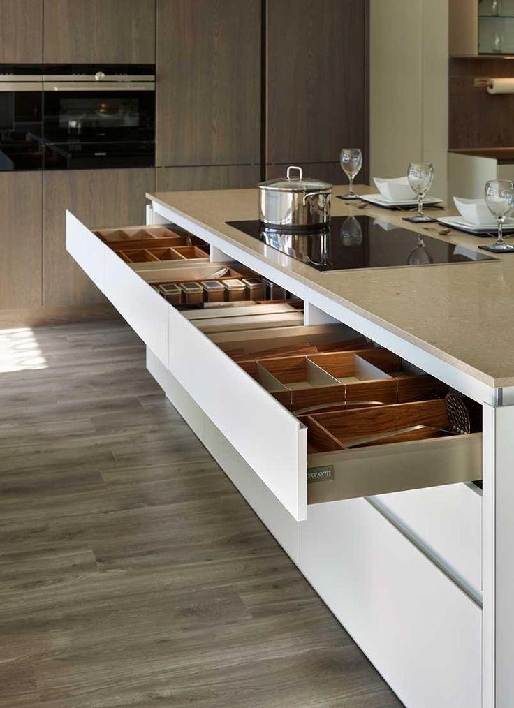 Snug Kitchens Newbury Pronorm Y-Line Matt Arctic White Island with Caesarstone Shitake workshops with Walnut Pronorm drawer interiors.