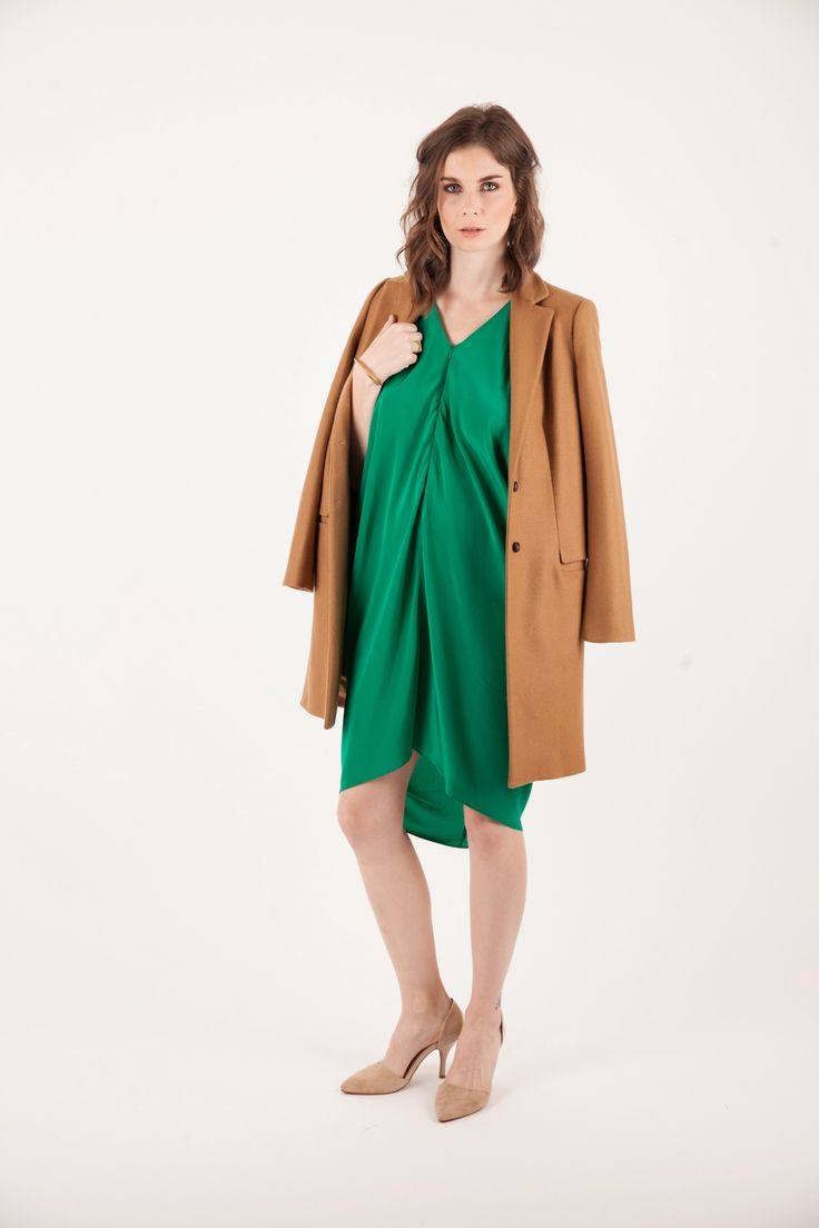 Kinwolfe Radiant Dress in Emerald Green | Maternity and Breastfeeding dress giving you 4+ Trimesters of Style with invisible zipper for nursing access. Styled for desk-to-date night with a camel coat and nude shoes. You can actually double-pump in our Radiant Dress! #breastfeeding #maternity