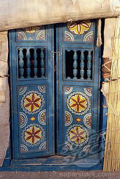 Close_up of decorated blue wooden doors to a yurt at Repeter, Turkmenistan