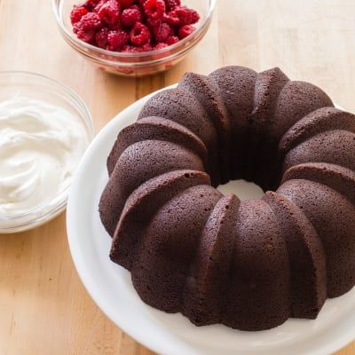 """Chocolate Sour Cream Bundt Cake by America's Test Kitchen -- For a chocolate Bundt cake recipe that would deliver a cake that tasted every bit as good as it looked, with a fine crumb, moist texture, and rich chocolate flavor, we used both bittersweet chocolate and natural cocoa, dissolving them in boiling water, which """"blooms"""" their flavor."""