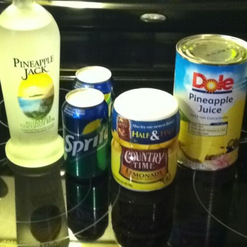 """Best. Drink. Ever."" 1 can pineapple juice (46oz), 1 cup Country Time lemonade mix, 2 cups water, 2 cans Sprite, and Pineapple Coconut Rum"